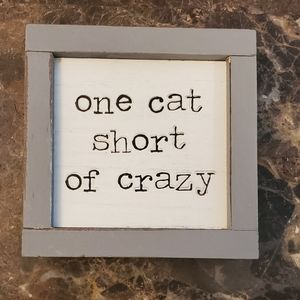 "Funny sign text ""One Cat Short of Crazy"" N…"